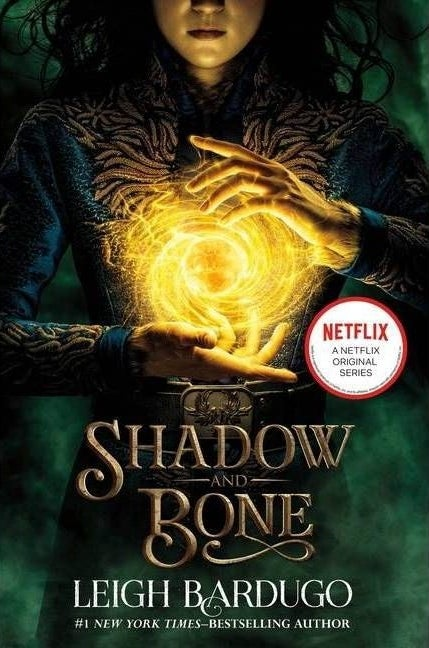 Green and gold cover of Shadow and Bone