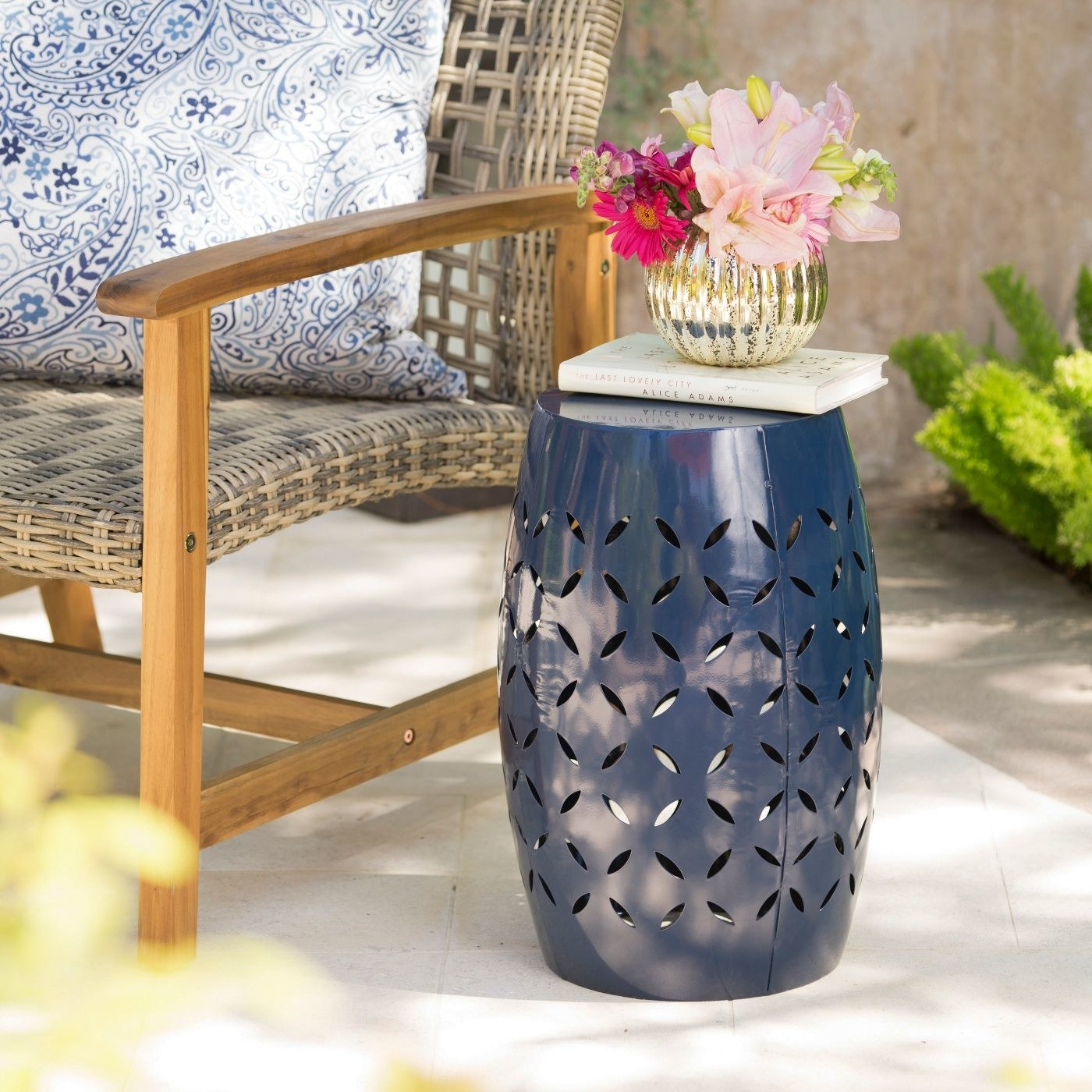 a blue vase with cut outs around it