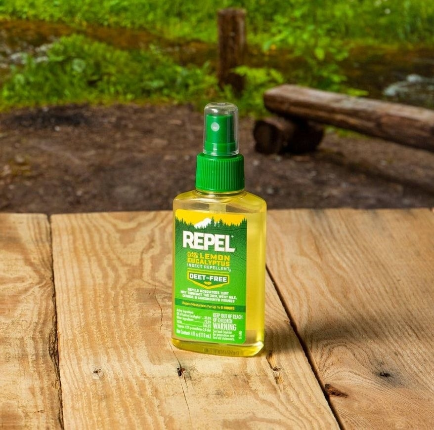yellow and green bottle of bug spray