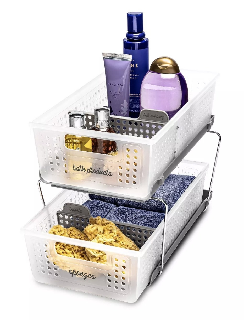 Under the sink storage holding shampoo and towels