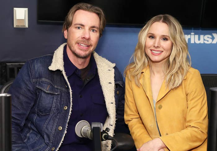 Dax and Kristen smile at a radio station appearance