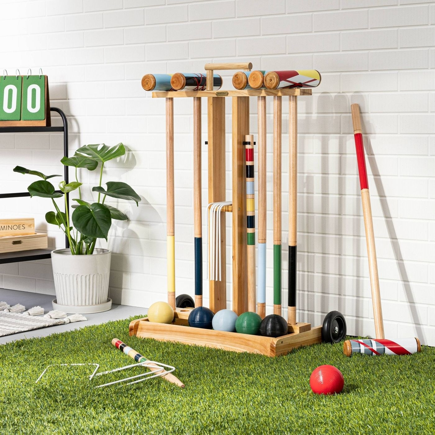 wooden game set with yellow, blue, navy, green, black and red balls