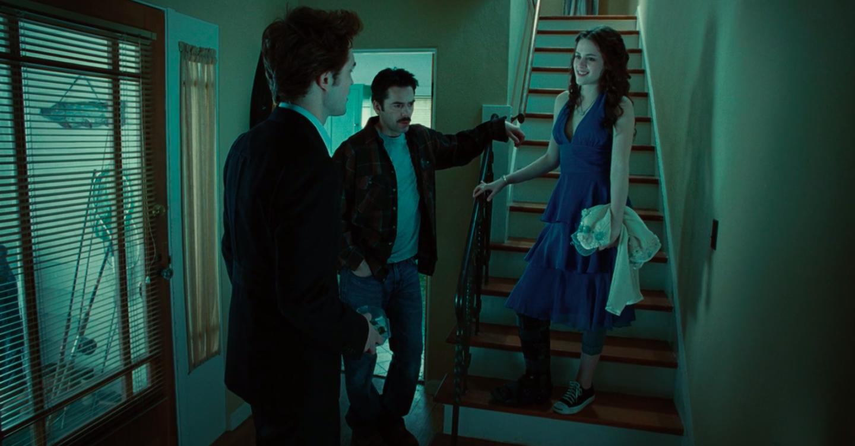 Bella wearing a blue prom dress and little leggings underneath