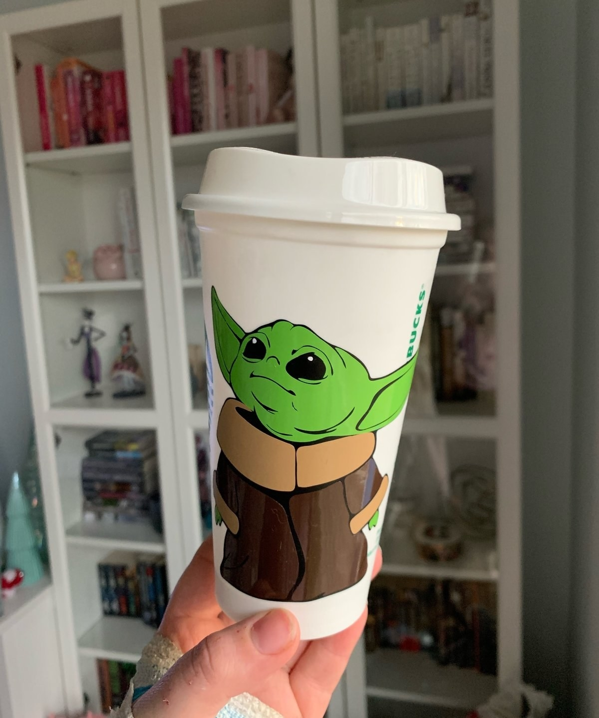 a hot cup with baby yoda on it