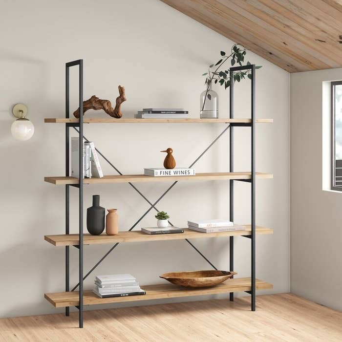 Bookcase with four shelves and black wooden frame