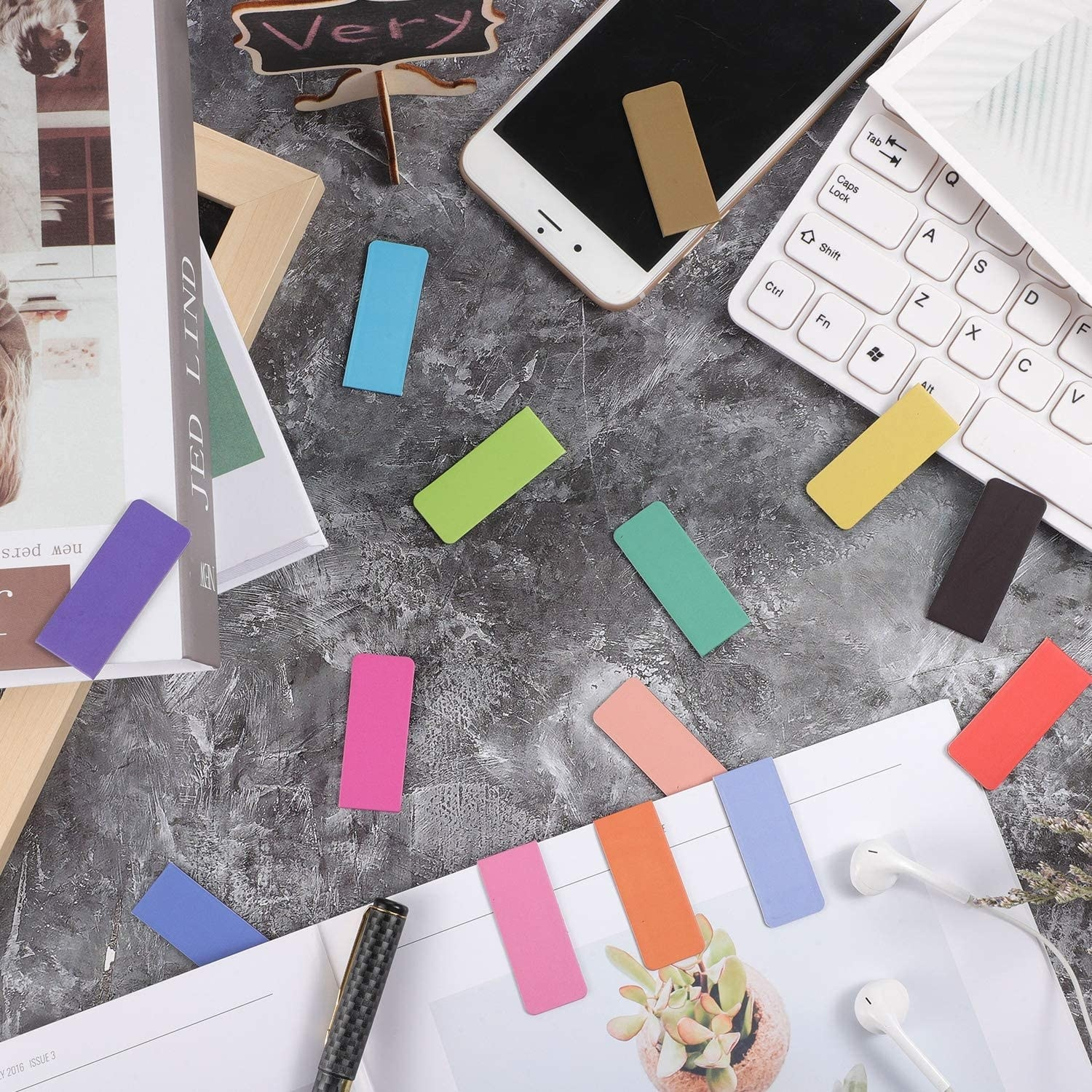 A flatlay of the magnetic bookmarks scattered on a desk