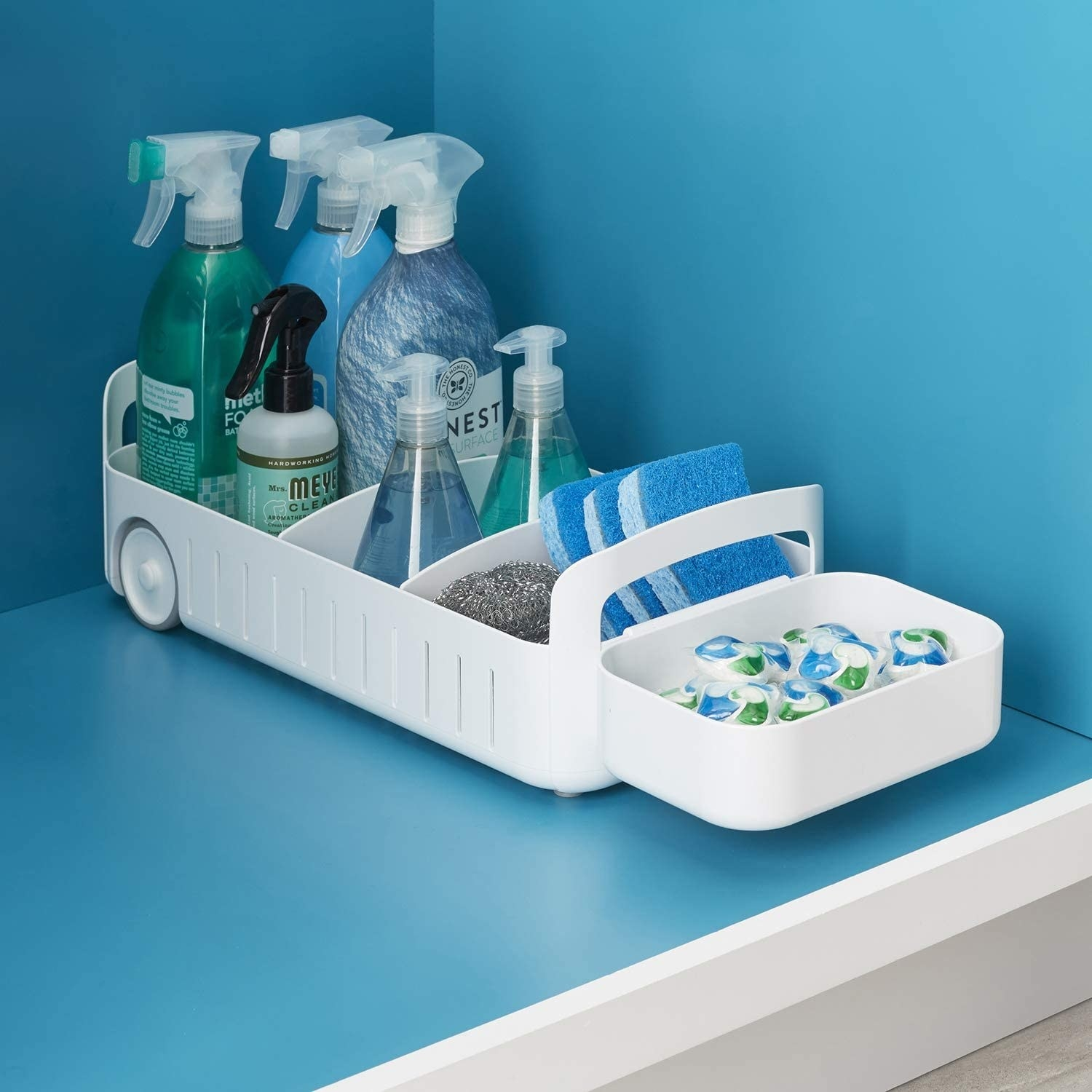 the caddy in a cabinet filled with cleaning products