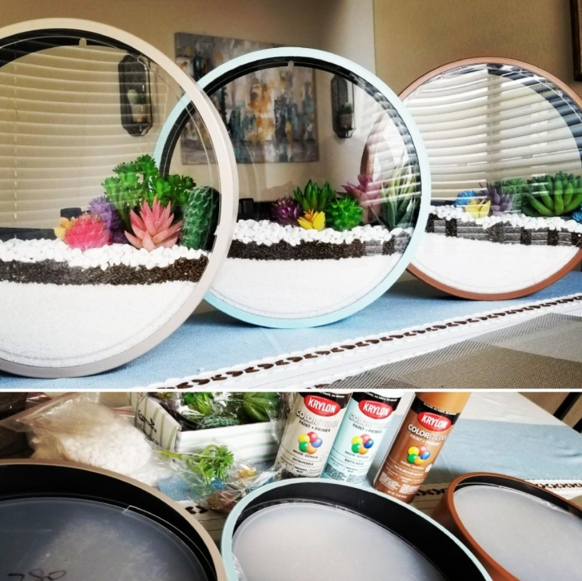 Three cans of Krylon spray paint being applied to homemade succulent planters