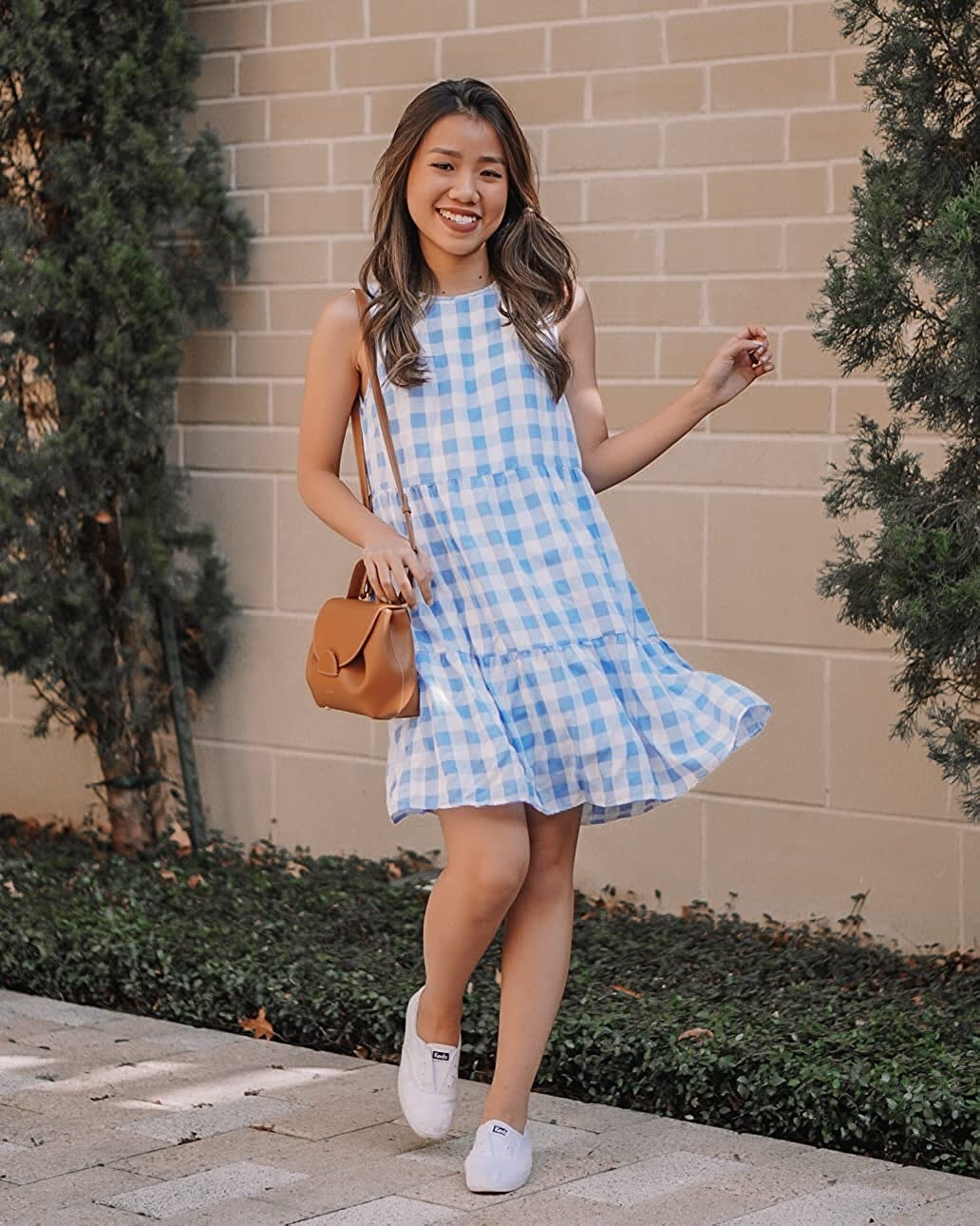 A model in the above-the-knee light blue and white dress