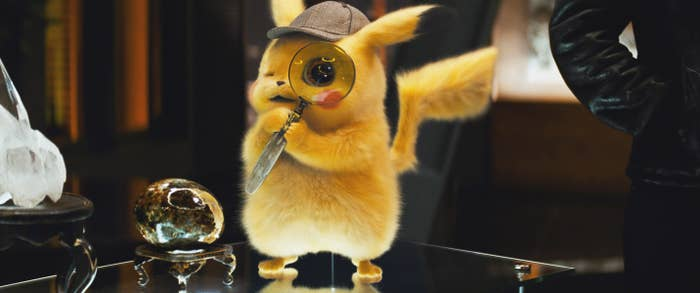 Detective Pikachu looking through a magnifying glass