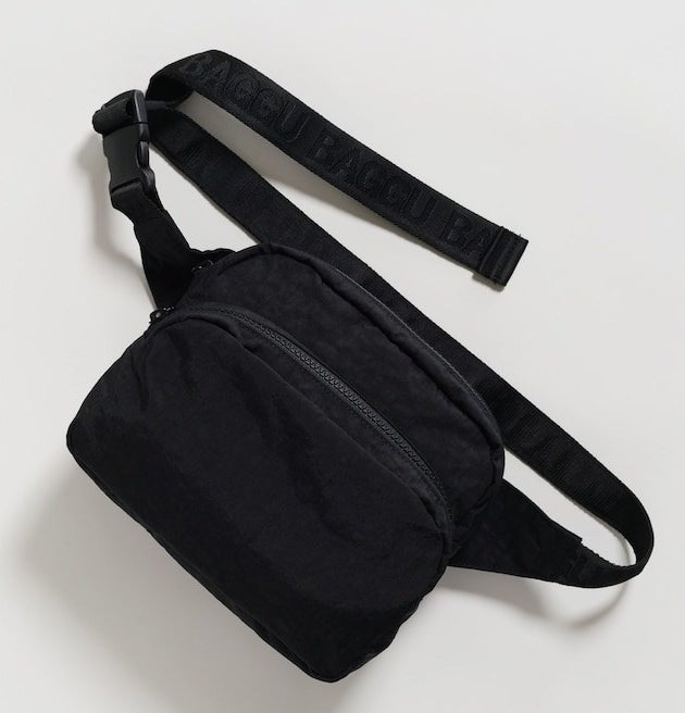a black fanny pack with two zippered pockets