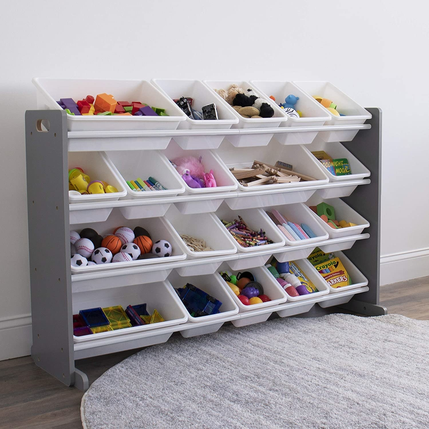 the storage shelf in a room with toys in the bins