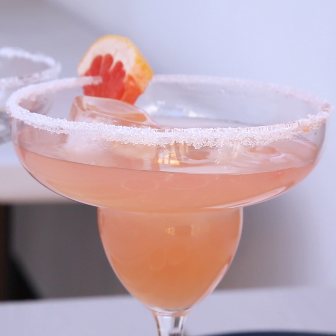A pink grapefruit margarita with a salted rim.