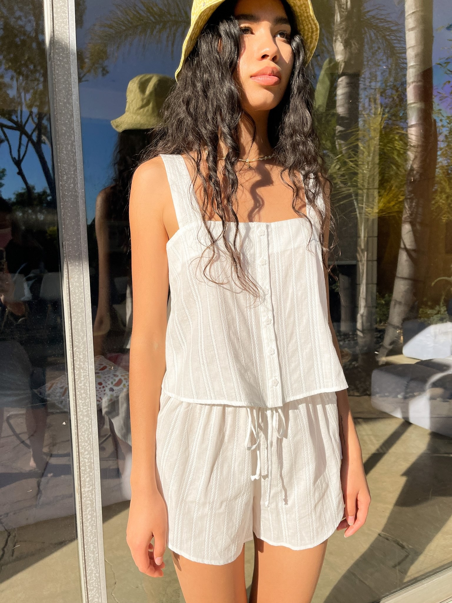 Model wearing shirt and short setn