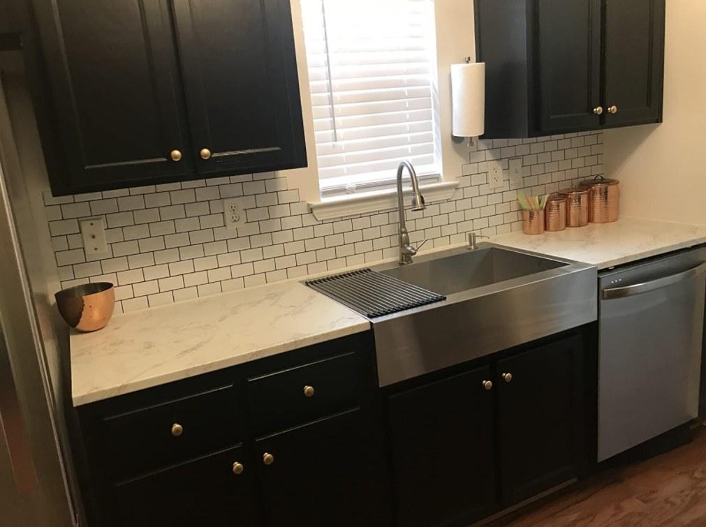 The tile backsplash in white applied in a kitchen