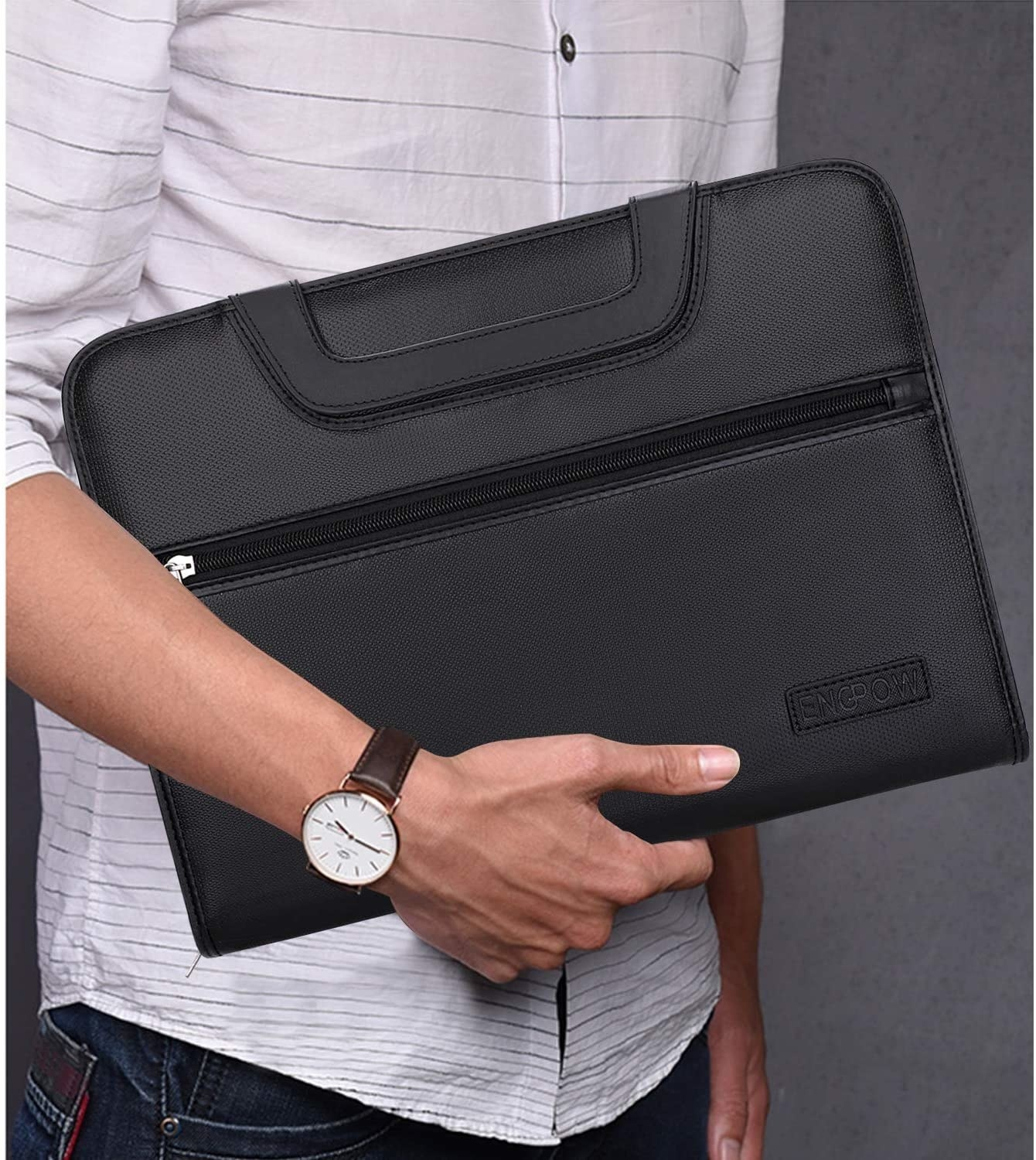 person holding the file folder
