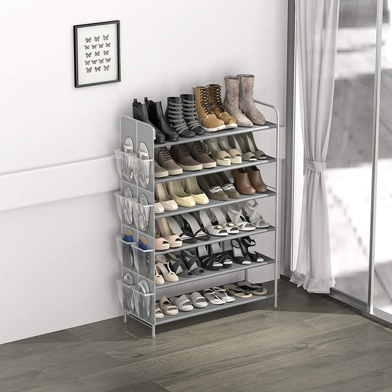a shoe rack filled with shoes and slippers on the side