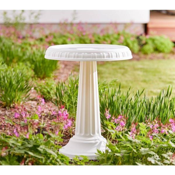 White bird bath in outdoor garden