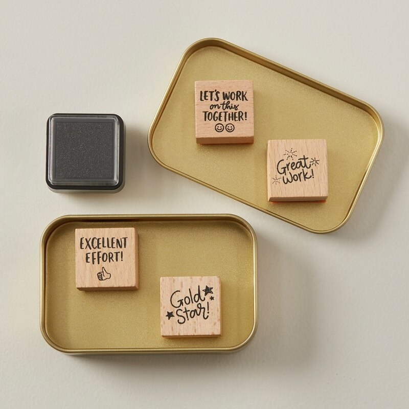 A set of four mini stamps with encouraging messages, like great work and excellent effort