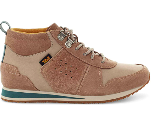 The brown suede sneakers showcasing the details on the side profile of the shoe