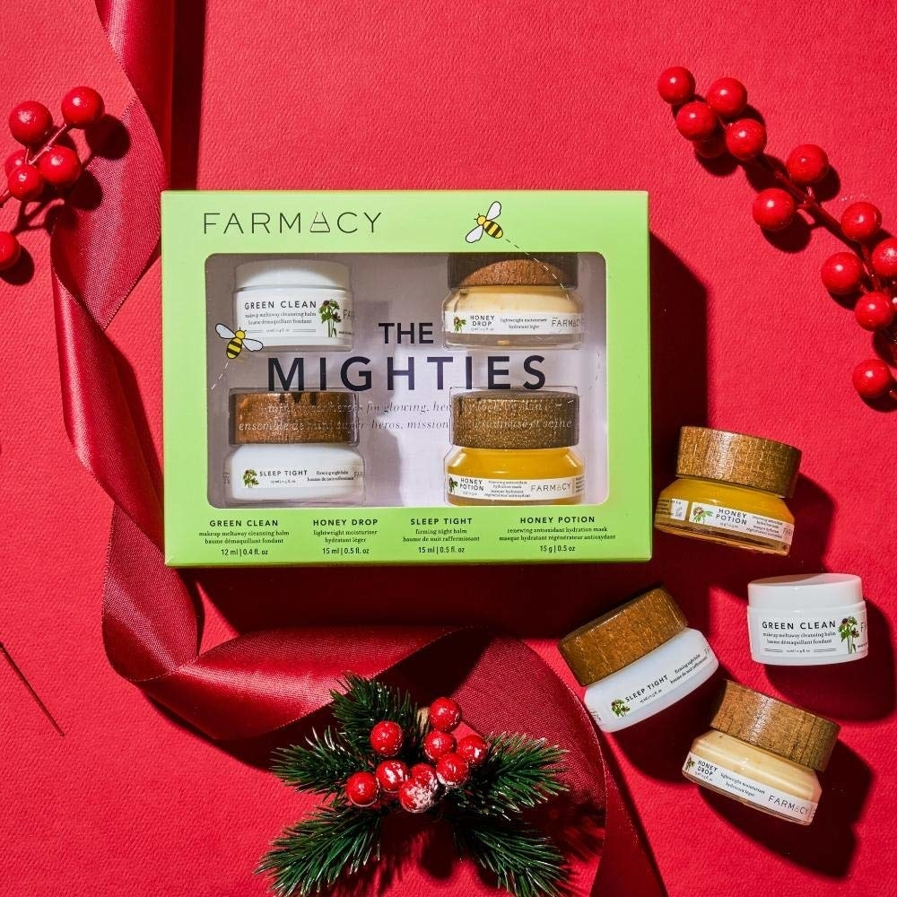 a flatlay of products in its packaging, along with ribbon and plants