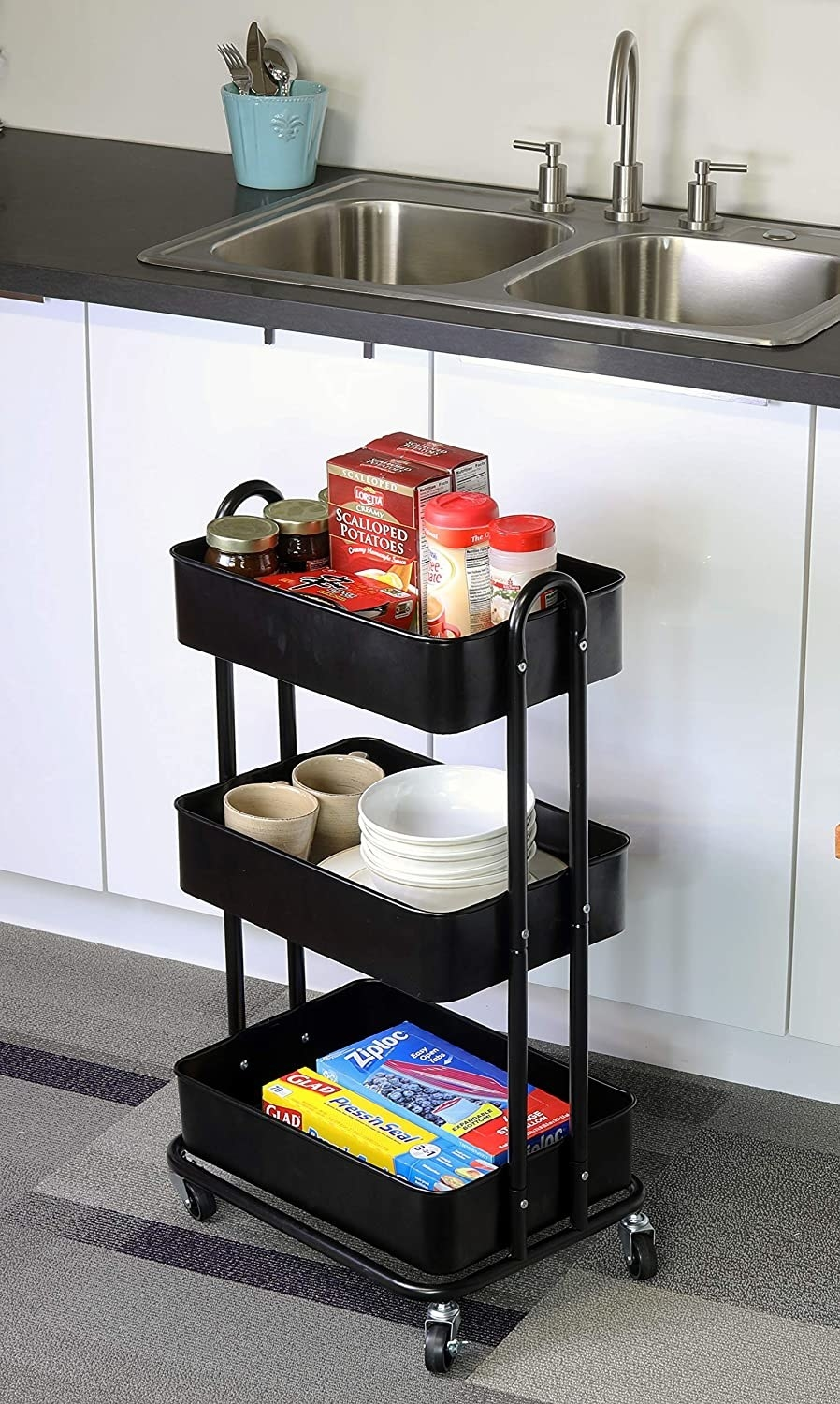 the cart in a kitchen with kitchen stuff in it like bowls and Ziploc bags