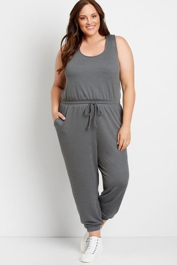 front view of a model wearing the sleeveless grey jumpsuit