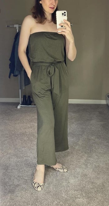 front view of a different reviewer wearing the jumpsuit in army green