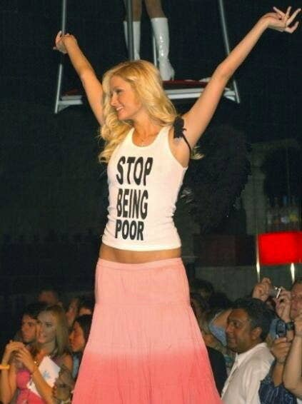 "Paris Hilton wearing a ""Stop Being Poor"" tank"