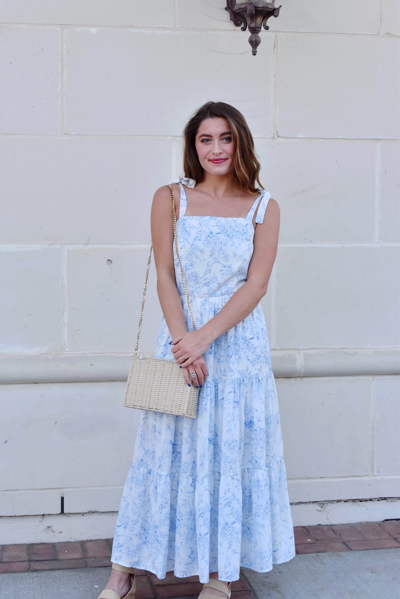 model wearing the blue and white midi dress with tie shoulder straps