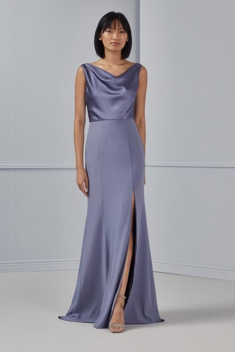 model wearing the blue high-slit dress