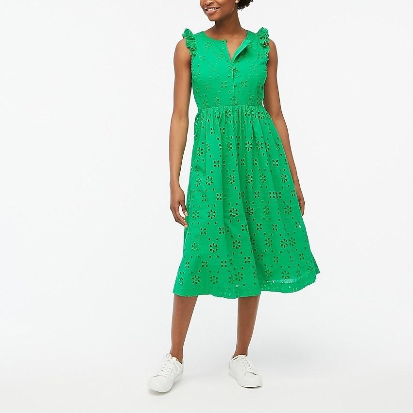 model wearing the sleeveless green eyelet dress
