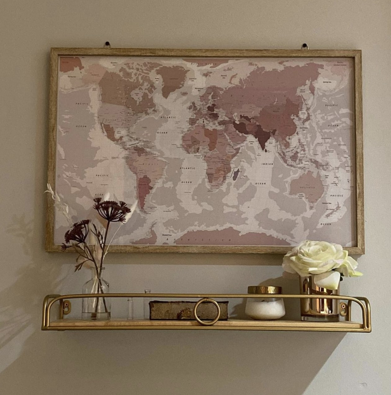 Floating shelf on wall with décor on it