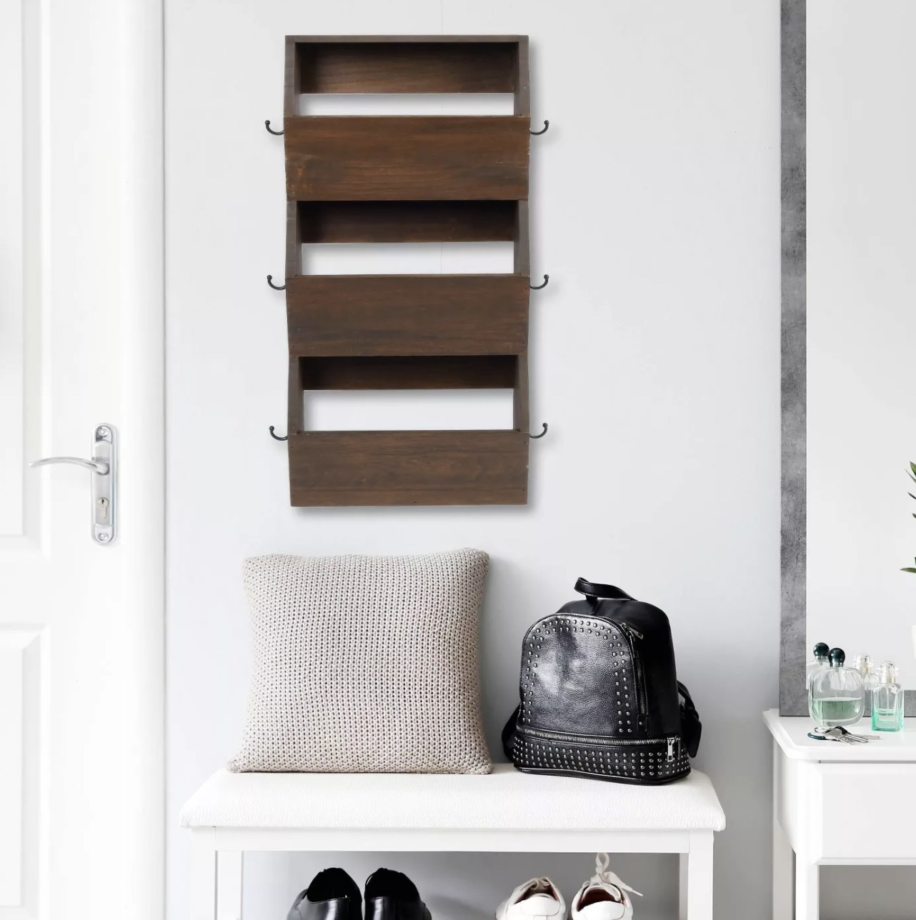 Hanging bins on entry way wall