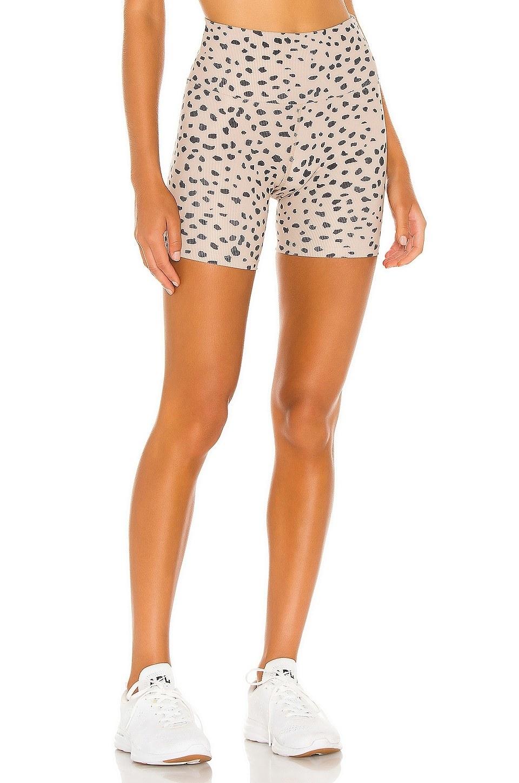 model wearing taupe polka-dot bike shorts