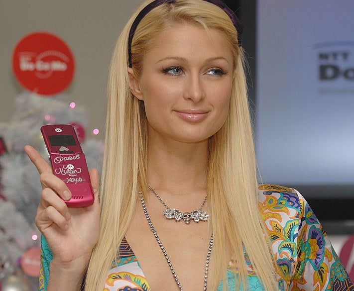 Paris Hilton holding up a Motorola Razr