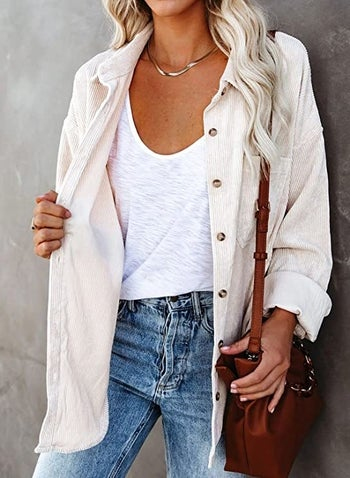model wearing it with white tank underneath and jeans
