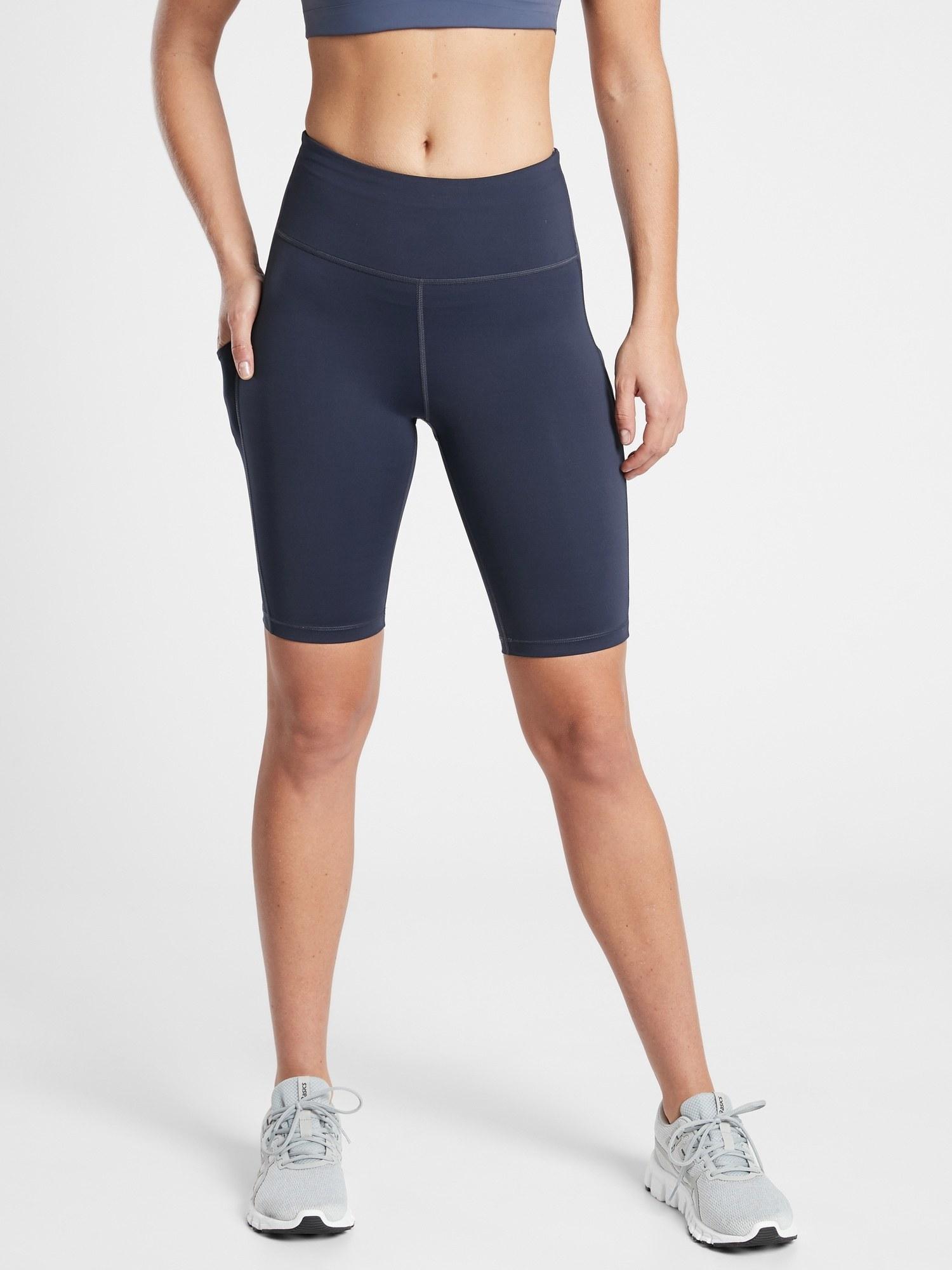 model wearing navy blue bike shorts