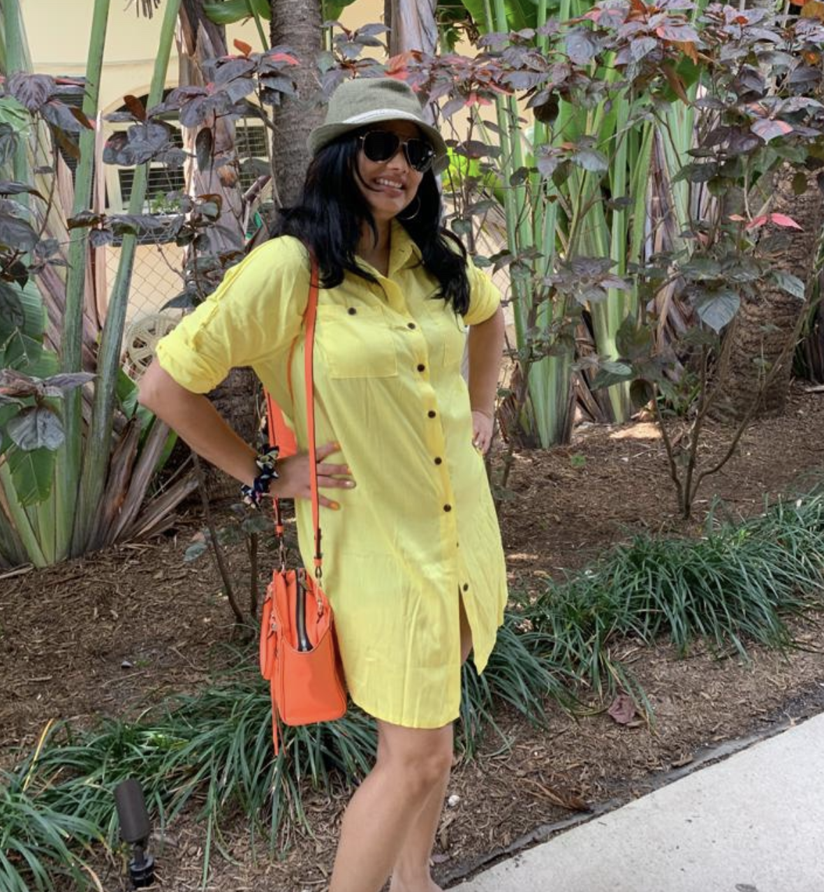 reviewer wearing the yellow button down