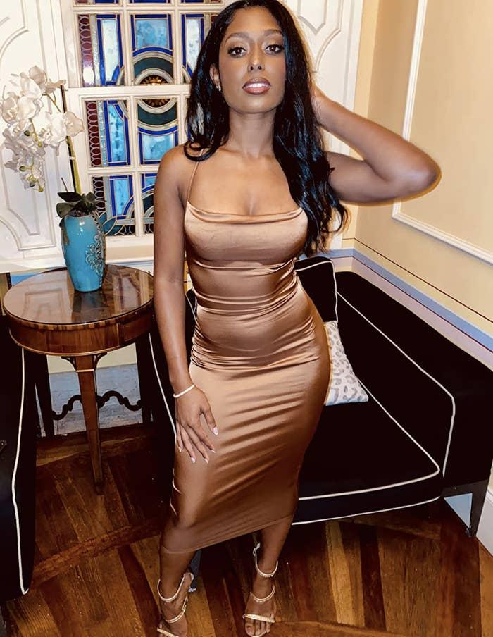 reviewer wearing gold midi dress