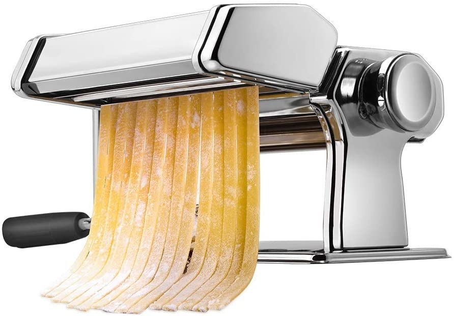 The machine and the dial used to create pasta with fettuccine coming out