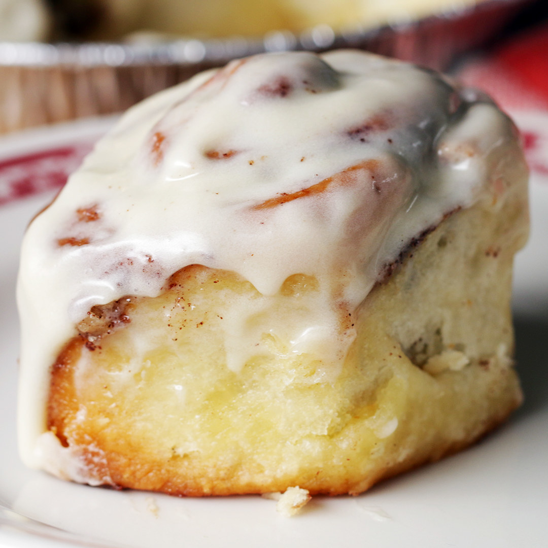 A homemade cinnamon roll with icing.