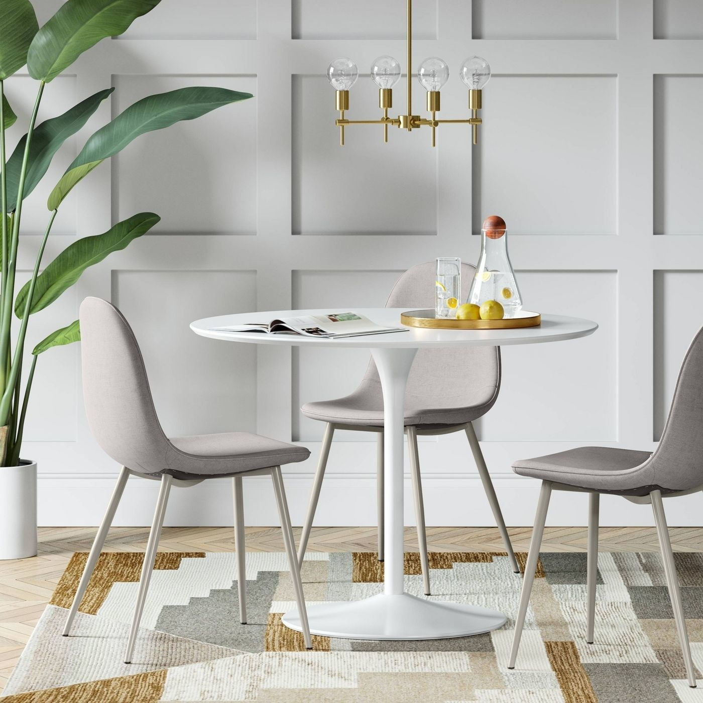 grey upholstered dining chairs around a round white table