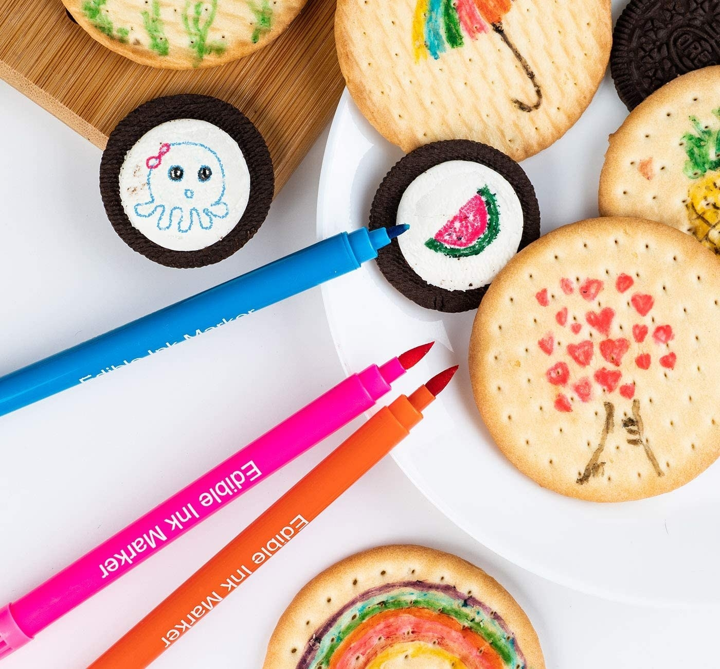 The pens next to Oreos and crackers with doodles on them