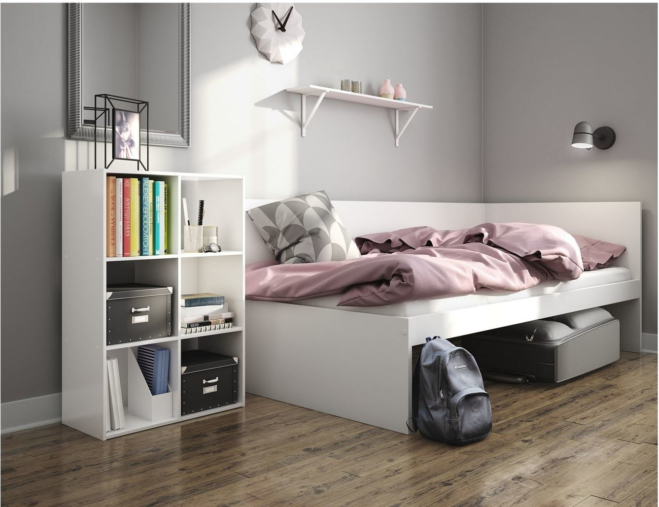 white 6-cube organizer holding various boxes and books next to a bed