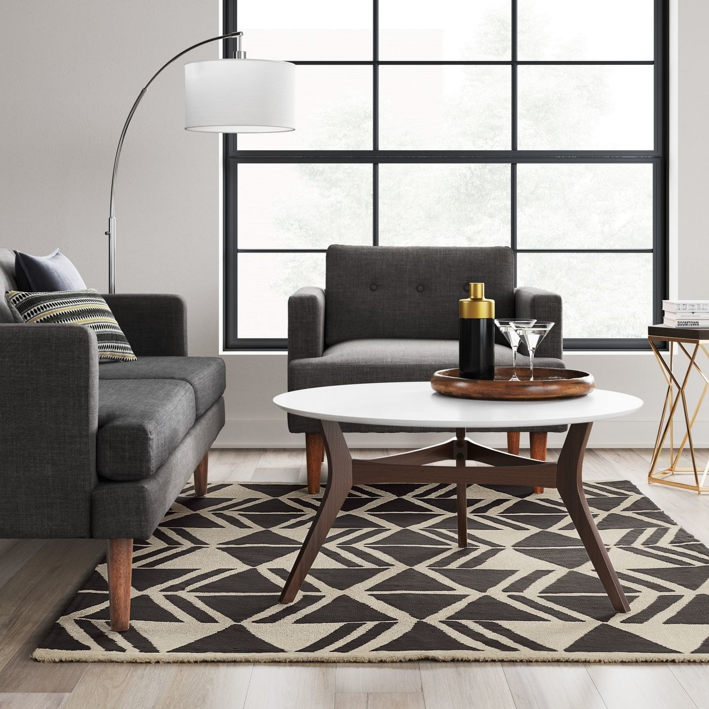 charcoal and cream rug with geometric pattern in a living room under a coffee table