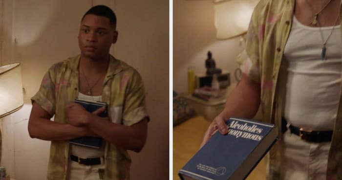 Damon holding an alcoholics anonymous book