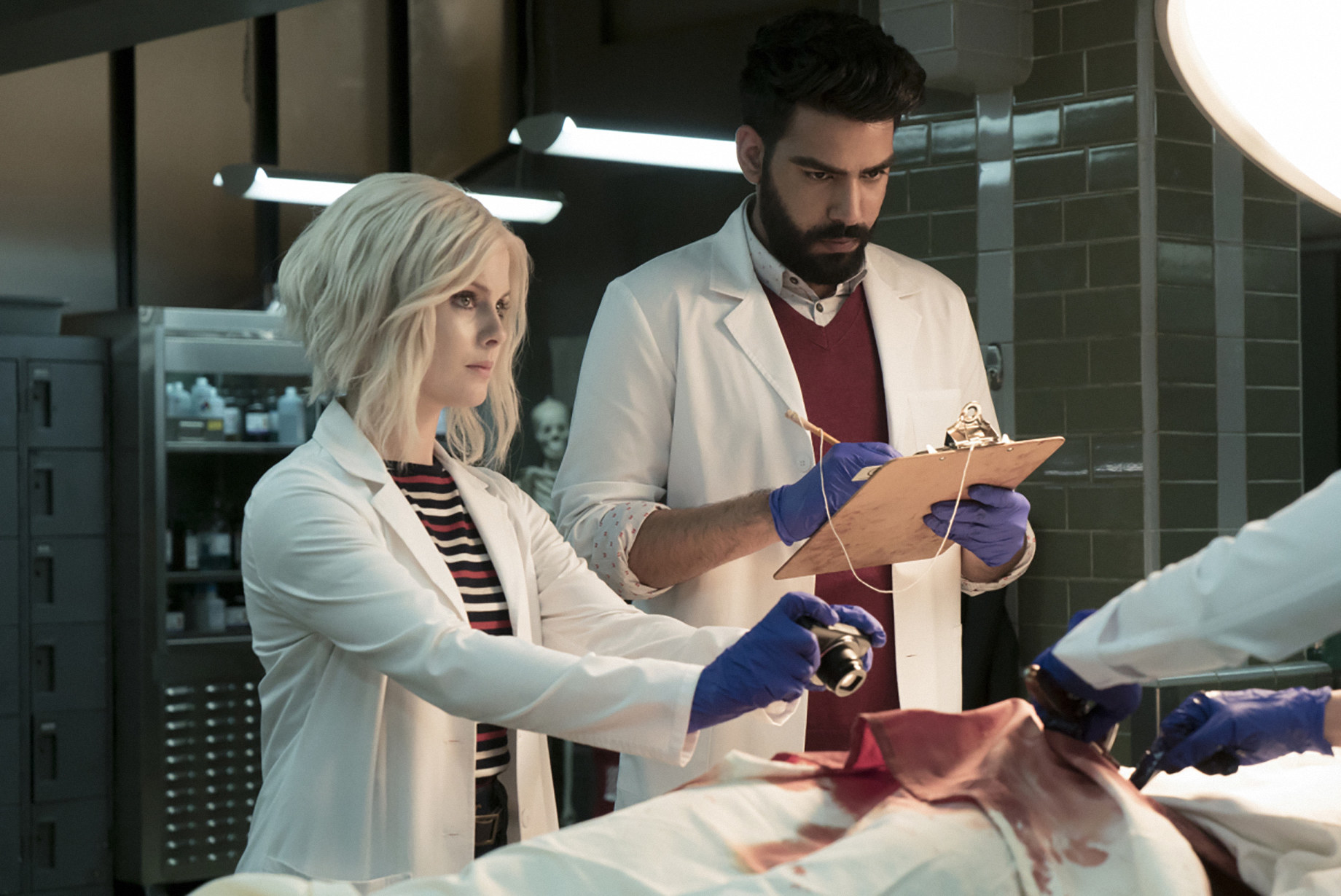 Two doctors perform an autopsy