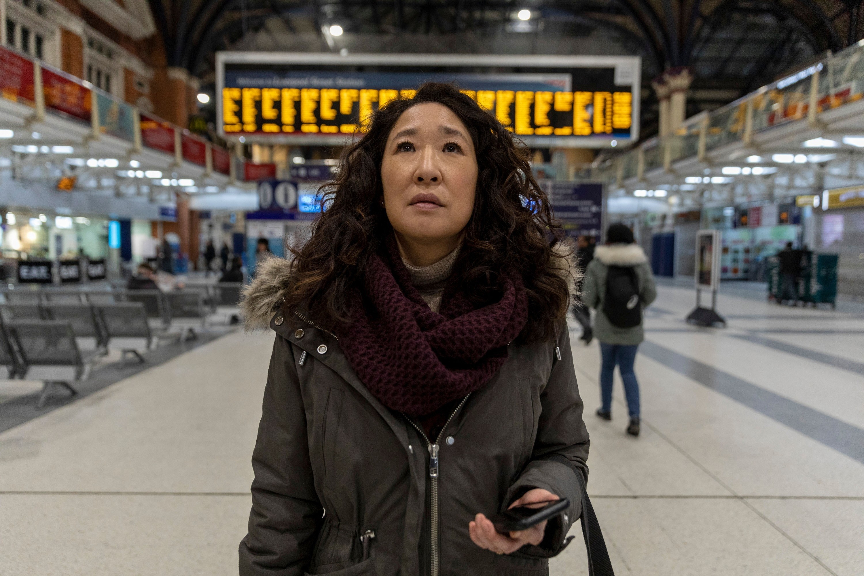 Sandra Oh in a train station