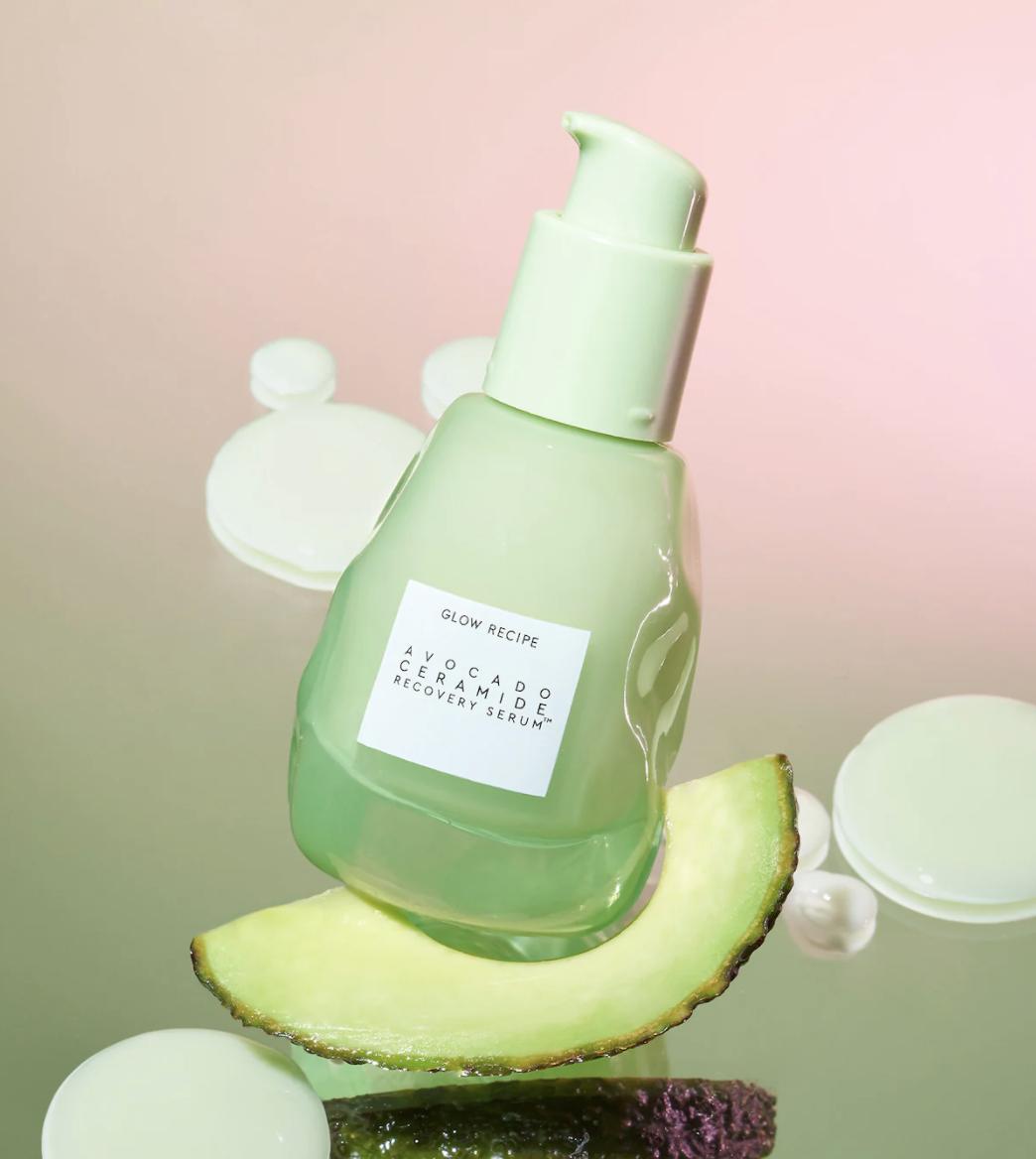 the bottle of serum on an avocado slice
